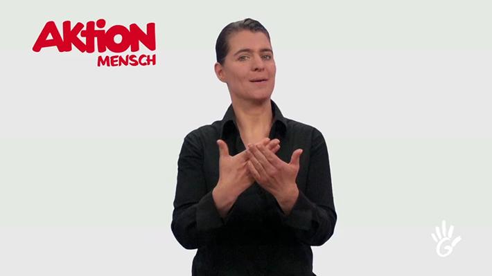 Eine Gebärdensprachendolmetscherin